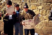 Nepalese reading newspapers. Kathmandu, Nepal. 1997 - Howard Davies - 03-05-1997