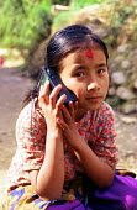 Girl listening to her radio in a village. Kathmandu district, Nepal. 1997 - Howard Davies - 03-05-1997