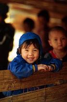 Karenni child at border refugee camp school. Camp Three, Thailand. 1996 - Howard Davies - 1990s,1996,asia,asian,asians,border,burma,burmese,camp,camps,CHILD,CHILDHOOD,children,Diaspora,displaced,edu,edu education,educate,educating,education,educational,foreign,foreigner,foreigners,immigran