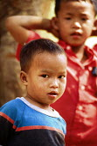 Karenni children at border refugee camp. Camp Three, Thailand. 1996 - Howard Davies - 1990s,1996,asia,asian,asians,border,burma,burmese,Camp,camps,CHILD,CHILDHOOD,children,Diaspora,displaced,foreign,foreigner,foreigners,immigrant,IMMIGRANTS,immigration,juvenile,juveniles,kid,kids,migra