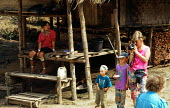Tourists visiting Padaung refugees from Burma, also known as long necks, in a model village. Padaung model village, Thai - Burma border. 1996 - Howard Davies - 1990s,1996,asia,asian,asians,burma,Burmese,camp,camps,CHILD,CHILDHOOD,children,Diaspora,displaced,FEMALE,foreign,foreigner,foreigners,holiday,holiday maker,holiday makers,holidaymaker,holidaymakers,HO