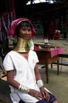 Padaung refugees woman from Burma in a model village. Padaung model village, Thai-Burma border. 1996 - Howard Davies - 1990s,1996,asia,asian,asians,burma,Burmese,camp,camps,Diaspora,displaced,FEMALE,foreign,foreigner,foreigners,holiday,holiday maker,holiday makers,holidaymaker,holidaymakers,holidays,immigrant,IMMIGRAN