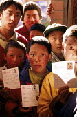 Tibetan refugees at a halfway house having walked from Tibet over the Himalayas to escape Chinese occupied Tibet.. Kathmandu. Nepal. 1997 - Howard Davies - 03-05-1997