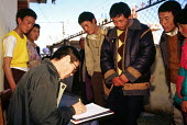 Tibetan refugees being registered upon arrival at a halfway house having walked from Tibet over the Himalayas to escape Chinese occupied Tibet. Kathmandu. Nepal. 1997 - Howard Davies - 03-05-1997