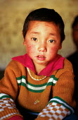 Tibetan refugee at a halfway house having walked from Tibet over the Himalayas to escape Chinese occupied Tibet.. Kathmandu. Nepal. 1997 - Howard Davies - 03-05-1997