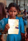 Tamil refugee child with IDP documents upon returning home having been refugees in India. Mannar Island reception centre, Sri Lanka. 1995 - Howard Davies - 03-05-1995