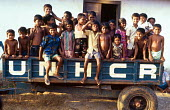 Tamil refugee children on UNHCR trailer at reception centre after returning from India. Trincomalee reception centre, Sri Lanka. 1995 - Howard Davies - 03-05-1995