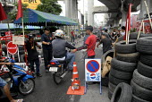 Supporters of Thaksin Shinawatra, the exiled former prime minister of Thailand, check vehicles at barricades established in the centre of Bangkok as part of the red shirt protest opposing the Thai Gov... - Howard Davies - 24-04-2010