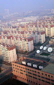 Residential housing development with satellite dishes, Qingdao, China - Howard Davies - 03-05-2001