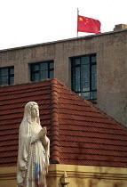 Catholic Church Madonna and Chinese flag in Qingdao. China. 2001 - Howard Davies - 03-05-2001