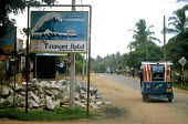 A sign for the Tsunami Hotel in Arugam Bay - the sign is the only thing remaining after the hotel was destroyed in the Tsunami. Sri Lanka 2005 - Howard Davies - 05-03-2005