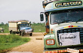 Two trucks carrying relief supplies chartered by Oxfam make their way to displaced people, survivors of the Tsunami disaster. Oxfam distribute non food essentials in the IDP camps to the north of Batt... - Howard Davies - 05-03-2005
