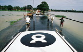 An Oxfam evaluation team negotiates flooded roads to the south of Batticaloa. The severe and early monsoon compounded the devastating effects of the Tsunami leaving many areas of the east coast floode... - Howard Davies - 05-03-2005