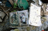 A familys belongings in the remains of a house in Tirukkovil a village largely destroyed by the Tsunami. Sri Lanka. 2005 - Howard Davies - 2000s,2005,asia,asian,developing,DIA,Diaspora,disaster,disasters,displaced,displacement,earthquake,earthquakes,environment,foreign,foreigner,foreigners,house,houses,idp,idps,immigrant,IMMIGRANTS,immig