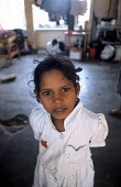 A child displaced by the Tsunami living in a displaced peoples camp set up in a school in Akkaraipattu, Sri Lanka. 2005 - Howard Davies - 2000s,2005,asia,asian,camp,camps,child,CHILDHOOD,children,developing,DIA,disaster,disasters,displaced,displacement,earthquake,earthquakes,edu,edu education,educate,educating,education,educational,envi