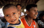 A child displaced by the Tsunami living in a displaced peoples camp set up in a school in Akkaraipattu, Sri Lanka. 2005 - Howard Davies - .,2000s,2005,asia,asian,camp,camps,child,CHILDHOOD,children,developing,DIA,disaster,disasters,displaced,displacement,earthquake,earthquakes,edu,educate,educating,education,educational,environment,I,id