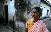 A woman who has lived through twenty years of civil war and survived the Tsunami outside her battered house to the north of Batticaloa, Sri Lanka. 2005 - Howard Davies - 2000s,2005,asia,asian,Civil War,conflict,conflicts,developing,DIA,Diaspora,disaster,disasters,displaced,displacement,earthquake,earthquakes,environment,fear,fearful,FEMALE,foreign,foreigner,foreigners