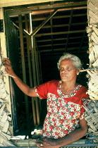 An elderly woman who narrowly survived the Tsunami and lost ten close relatives including her husband outside her temporary shelter, Navaladi, Batticaloa, Sri Lanka 2005 - Howard Davies - 05-03-2005