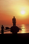 A fisherman stands on his boat early on the morning of the six month commemoration of the Tsunami on Navaladi beach where more than 700 villagers were lost in the Tsunami. Batticaloa, Sri Lanka 2005 - Howard Davies - 05-03-2005