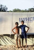 Two teenage boys who both lost close relatives in the tsunami in UNHCR tents. Navaladi beach, Batticaloa, Sri Lanka 2005 - Howard Davies - 05-03-2005