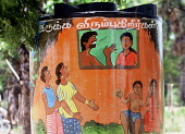 Murals to promote positive parenting especially from fathers and challenging domestic violence on Oxfam water tanks in camps for families displaced by the Tsunami. Batticaloa district, Sri Lanka. 2005 - Howard Davies - 05-03-2005