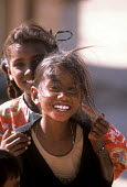 Tamil children, whose families were displaced by the Tsunami, playing outside temporary shelters, Batticaloa district, Sri Lanka 2005 - Howard Davies - 05-03-2005