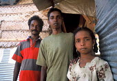 Father with his two children who lost their mother during the Tsunami and have been assisted by a local NGO supported by Oxfam. Batticaloa district, Sri Lanka 2005 - Howard Davies - 05-03-2005