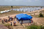 Views of the new section of Guyatree Mandanai Temple IDP camp in Tirukkovil District - established following the Tsunami - the semi - permanent shelters constructed by MSF replace the original tents a... - Howard Davies - 05-03-2005