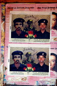 Posters commemorating the first man and woman Tamil Tigers suicide bombers displayed on Black Tiger day in Kilinochchi, Sri Lanka 2005 - Howard Davies - 2000s,2005,ACE,armed forces,asia,asian,BOMB,bombing,bombings,BOMBS,conflict,conflicts,culture,displaced,displacement,FEMALE,idp,idps,internally,Internally Displaced Person,Internally Displaced Persons