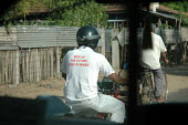 Aid worker wearing a landmines awareness shirt, Batticaloa district, Sri Lanka 2005 - Howard Davies - 05-03-2005