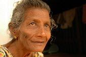 An elderly woman outside her transitional shelter provided by Oxfam in Sri Lanka 2005 - Howard Davies - 05-03-2005