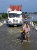 A Red Cross truck delivering aid supplies negotiates flooded roads to the south of Batticaloa. The severe and early monsoon compounded the devastating effects of the Tsunami leaving many areas of the... - Howard Davies - 05-03-2005