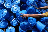Blue buckets part of an Oxfam hygiene kit being prepared for distribution to displaced people survivors of the Tsunami disaster who receive non food essentials in IDP camps to the north of Batticaloa... - Howard Davies - 05-03-2005
