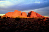 Mount Olgas at sunset, near Alice Springs. - Howard Davies - &,1990,1990s,attraction,attractions,Australian,Australians,Beings,belief,cloud,clouds,conviction,country,countryside,eni environmental issues,faith,formation,formations,GOD,holiday,holiday maker,holid