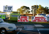 Protest banners and signs against cigarette smoking. Warning that smoking causes lung cancer. - Howard Davies - 03-05-1985