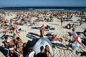 British tourists celebrating Christmas, on Bondi beach. - Howard Davies - 2000s,2003,attraction,attractions,Australian,Australians,beach,beaches,bikini,bikinis,celebrate,celebrates,celebrating,celebration,celebrations,Christmas,coast,coastal,coastline,coastlines,coasts,drin