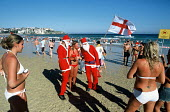 British tourists celebrating Christmas, on Bondi beach. - Howard Davies - 2000s,2003,attraction,attractions,Australian,Australians,bather,bathers,bathing,beach,beaches,bikini,bikinis,camera,cameras,CELEBRATE,celebrating,Christmas,coast,coastal,coastline,coastlines,coasts,dr