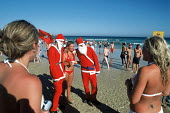 British tourists celebrating Christmas, on Bondi beach. - Howard Davies - 2000s,2004,attraction,attractions,Australian,Australians,bather,bathers,bathing,beach,beaches,bikini,bikinis,camera,cameras,CELEBRATE,celebrating,Christmas,coast,coastal,coastline,coastlines,coasts,dr