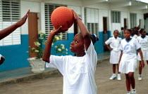 Jamaican school children playing basketball at school. - Howard Davies - 03-08-1997