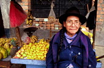 Elderly fruit seller in La Victoria shanty town, Lima. - Howard Davies - 03-08-1997