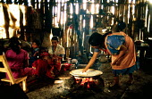 Guatemalan Maya refugee woman preparing food early in the morning, El Porvenir refugee camp in Campeche. - Howard Davies - 03-05-1990