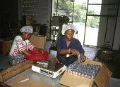 Jamaican women working at Mavis Bank coffee factory, in the Blue Mountains. - Howard Davies - 03-08-1997