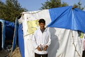 An asylum seeker from Afghanistan in the Pashtun camp known as the Jungle which is home to hundreds of migrants camped in makeshift huts in sand dunes near the port of Calais, France 2009 - Howard Davies - 16-07-2009