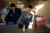 Asylum seekers from Afghanistan in an improvised shop in the Pashtun camp known as the Jungle which is home to hundreds of migrants camped in makeshift huts in sand dunes near the port of Calais, Fran... - Howard Davies - 16-07-2009