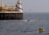 Jet skies close to Brighton Pier on the 19th July 2006 which registered the highest recorded temperature in UK. Brighton , UK 2006 - Howard Davies - 19-07-2006