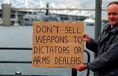 Activist at a protest against an arms trade fair London, UK 2001 - Howard Davies - 01-08-2001