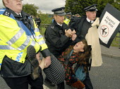 Police arrest protesters against the BAA proposed expansion of Heathrow airport and the environmental damage of air travel at the Camp for Climate Change near Heathrow airport. UK 2007 - Howard Davies - 19-08-2007