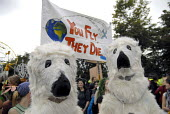 Protesters dressed as polar bears demonstrate against the BAA proposed expansion of Heathrow airport and the environmental damage of air travel at the Camp for Climate Change near Heathrow airport. UK... - Howard Davies - 19-08-2007