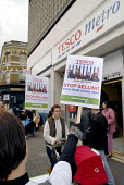 Protest outside a Tesco supermarket by Compassion in World Farming against egg production from caged hens, London, UK 2007 - Howard Davies - 2000s,2007,activist,activists,against,animal,Animal Rights,animals,battery,campaign,campaigner,campaigners,campaigning,CAMPAIGNS,capitalism,chicken,chickens,DEMONSTRATING,demonstration,demonstrations,
