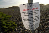Notice warning the public not to take timber from the thousands of tons of wood washed ashore on Worthing beach following the sinking of the cargo ship Ice Prince during a winter storm. The wood is be... - Howard Davies - 22-01-2008